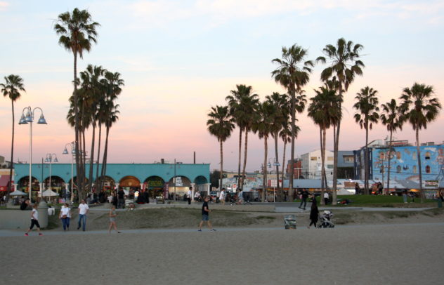 venice beach street people in sunset boardwalk oceanfront walk